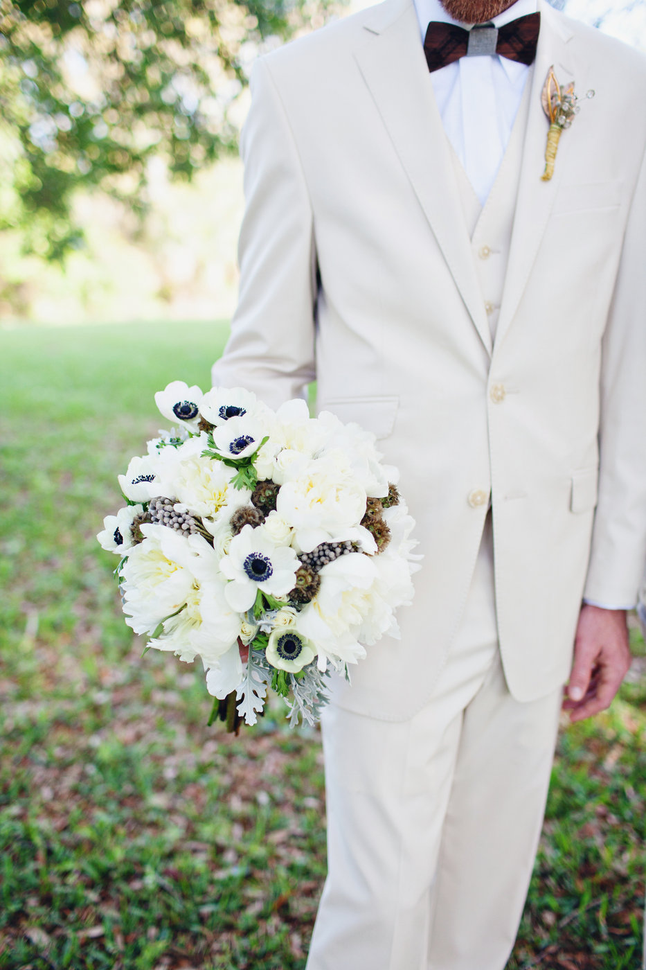 groomsman with bouquet